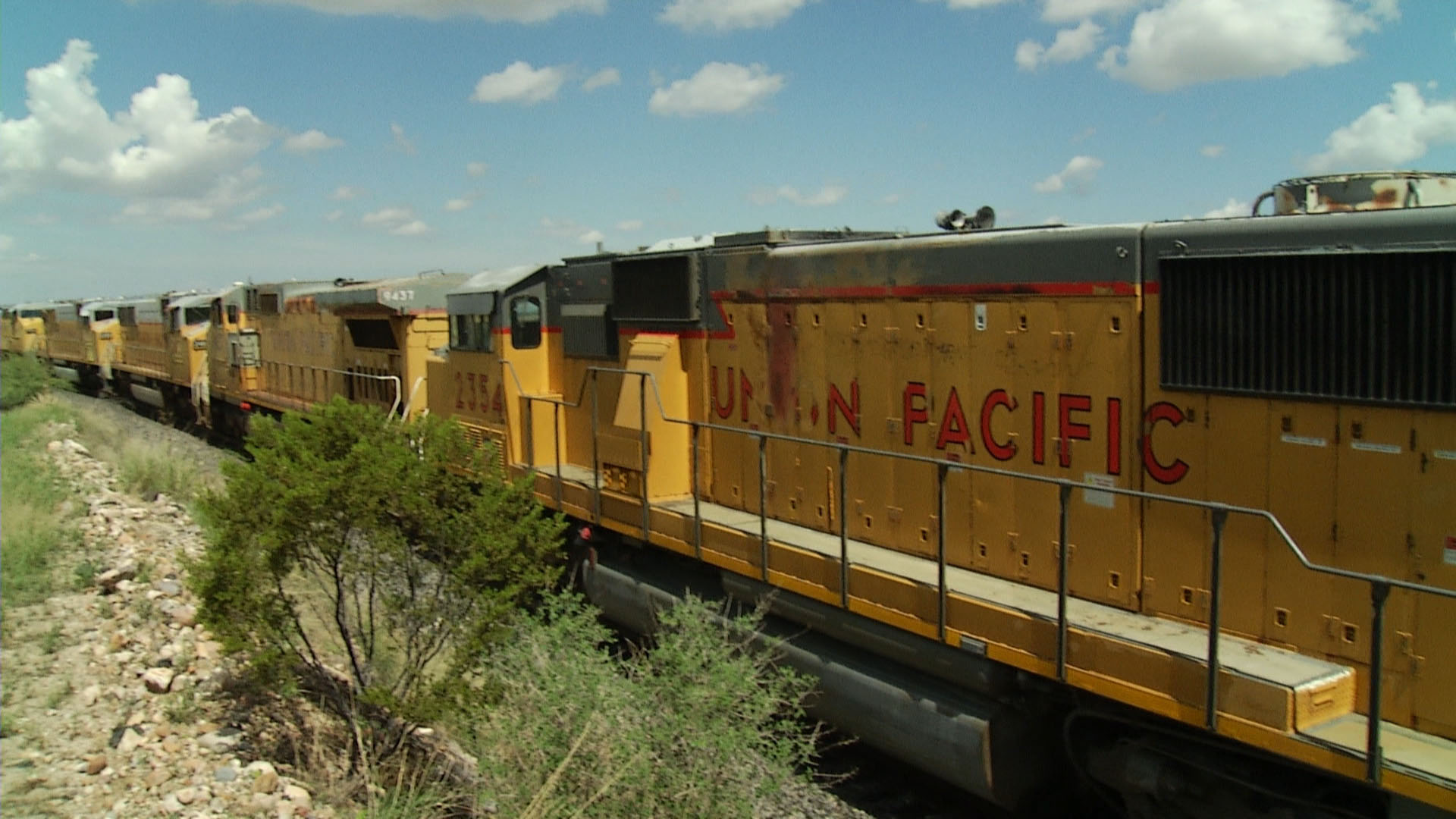A Union Pacific cargo freight train sits idle on a track in Cochise County.