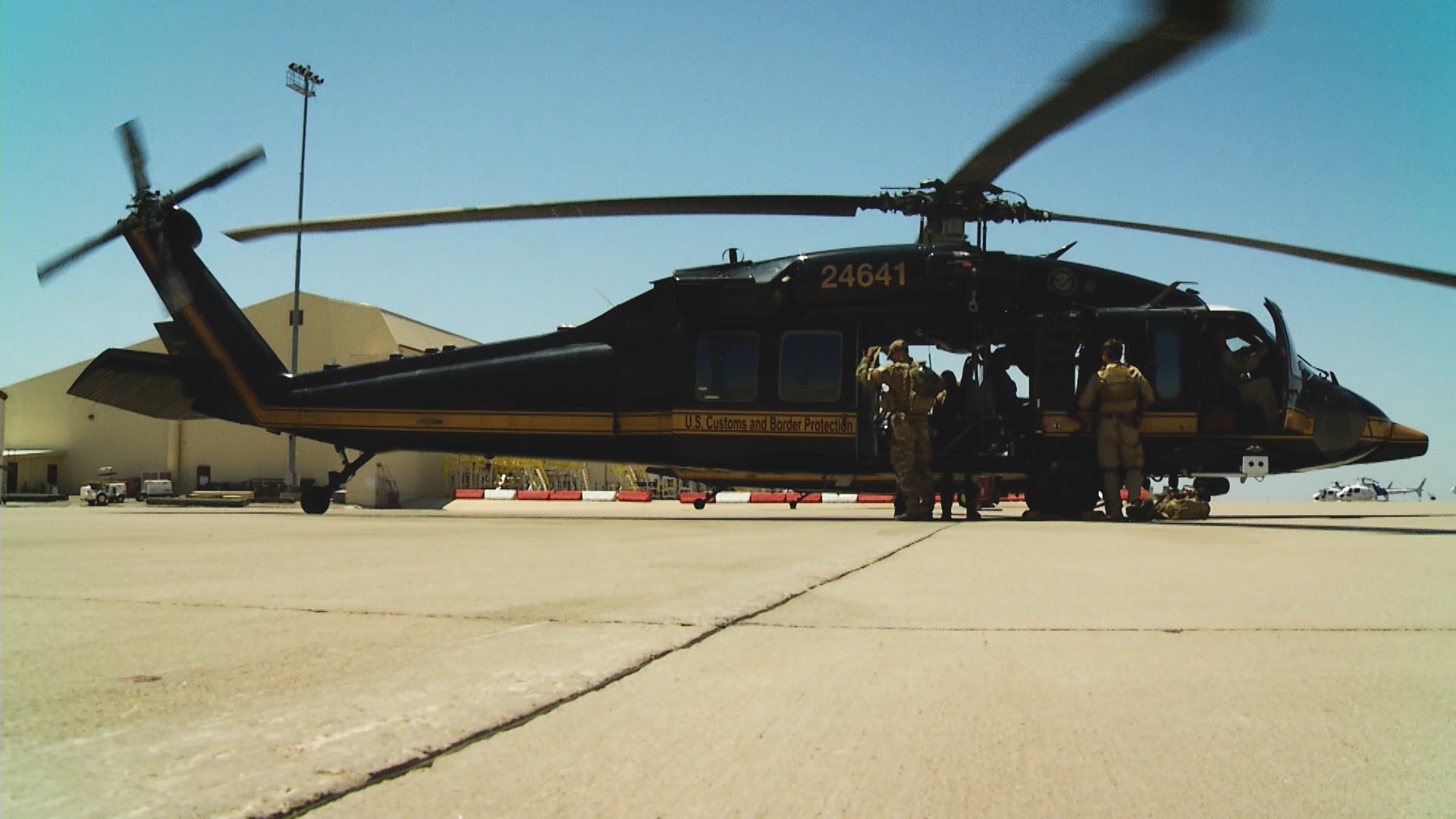 A Black Hawk helicopter used by Border Patrol sits on the tarmac at Davis-Monthan Air Force Base.