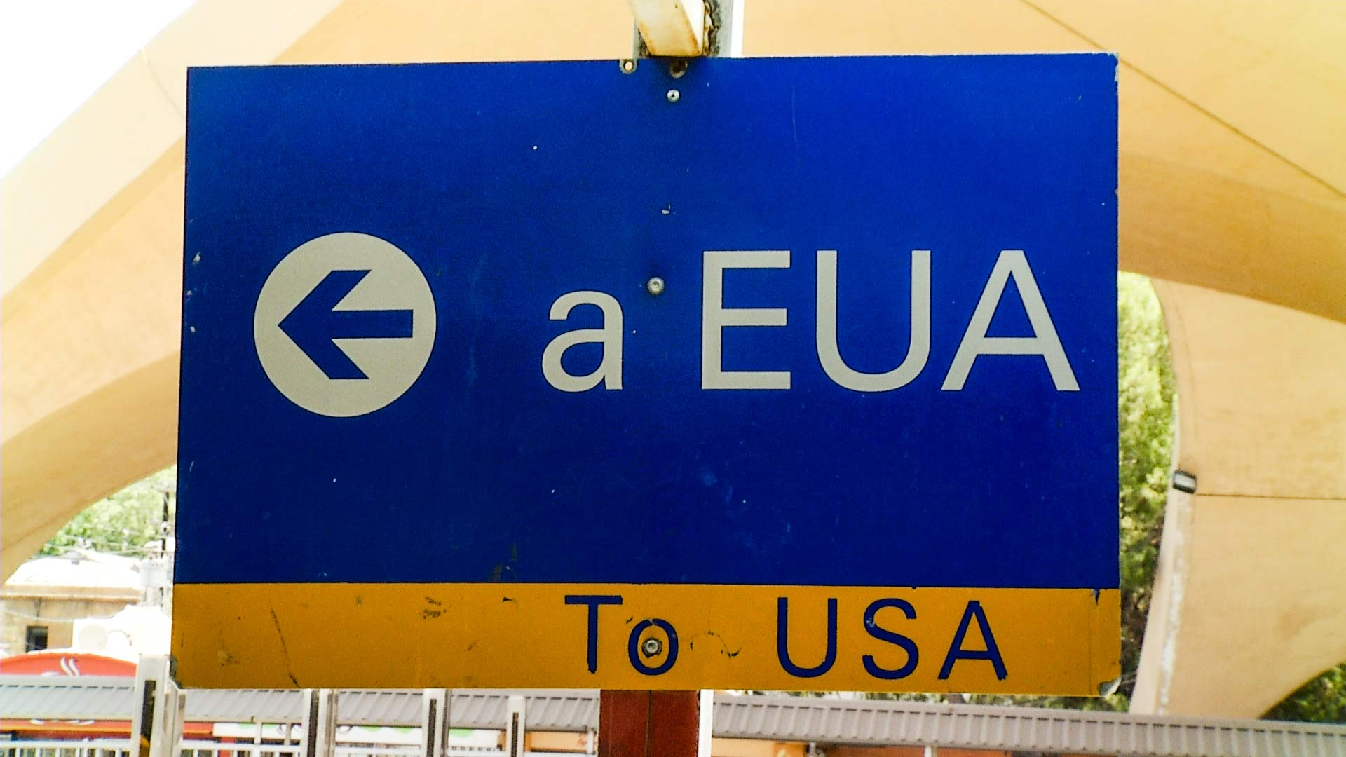 A sign pointing in the direction of the U.S. at a port of entry Nogales, Mexico.