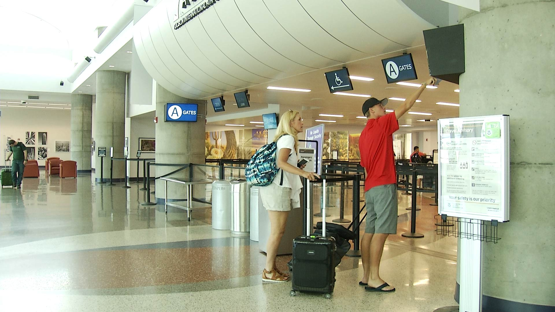 Passengers approach the remodeled security checkpoint at Tucson International Airport.