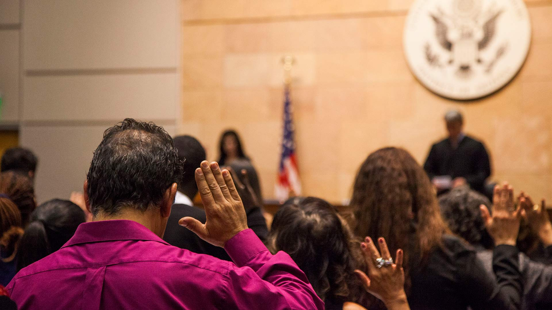 Soon-to-be U.S. citizens taking an oath at a naturalization ceremony at the Evo A. DeConcini U.S. Courthouse in Tucson, February 2018.