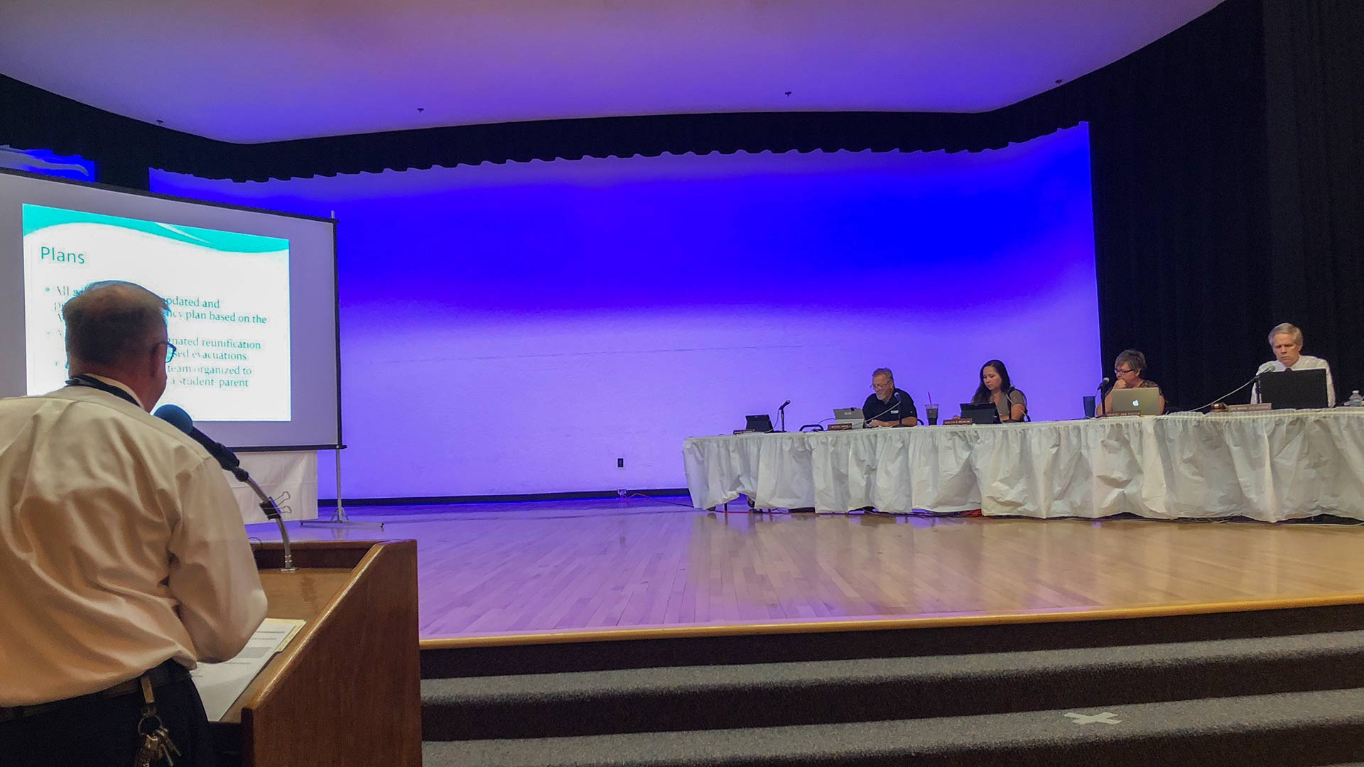 Tucson Unified School District holds town hall meeting on June 5, 2018. During the meeting, School Safety Director Jeffrey Coleman, left, presents an emergency-preparedness presentation.