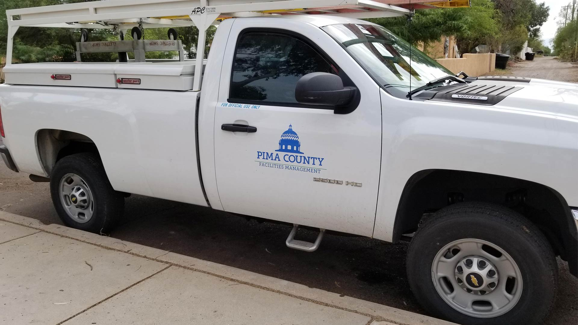 A Pima County Facilities Management truck parked outside Himmel Park, July 2018.