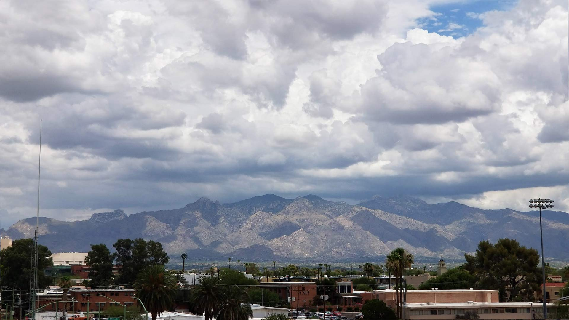 Monsoon clouds build up over the Catalina Mountains in this photo shot from the University of Arizona campus. From July 2018.