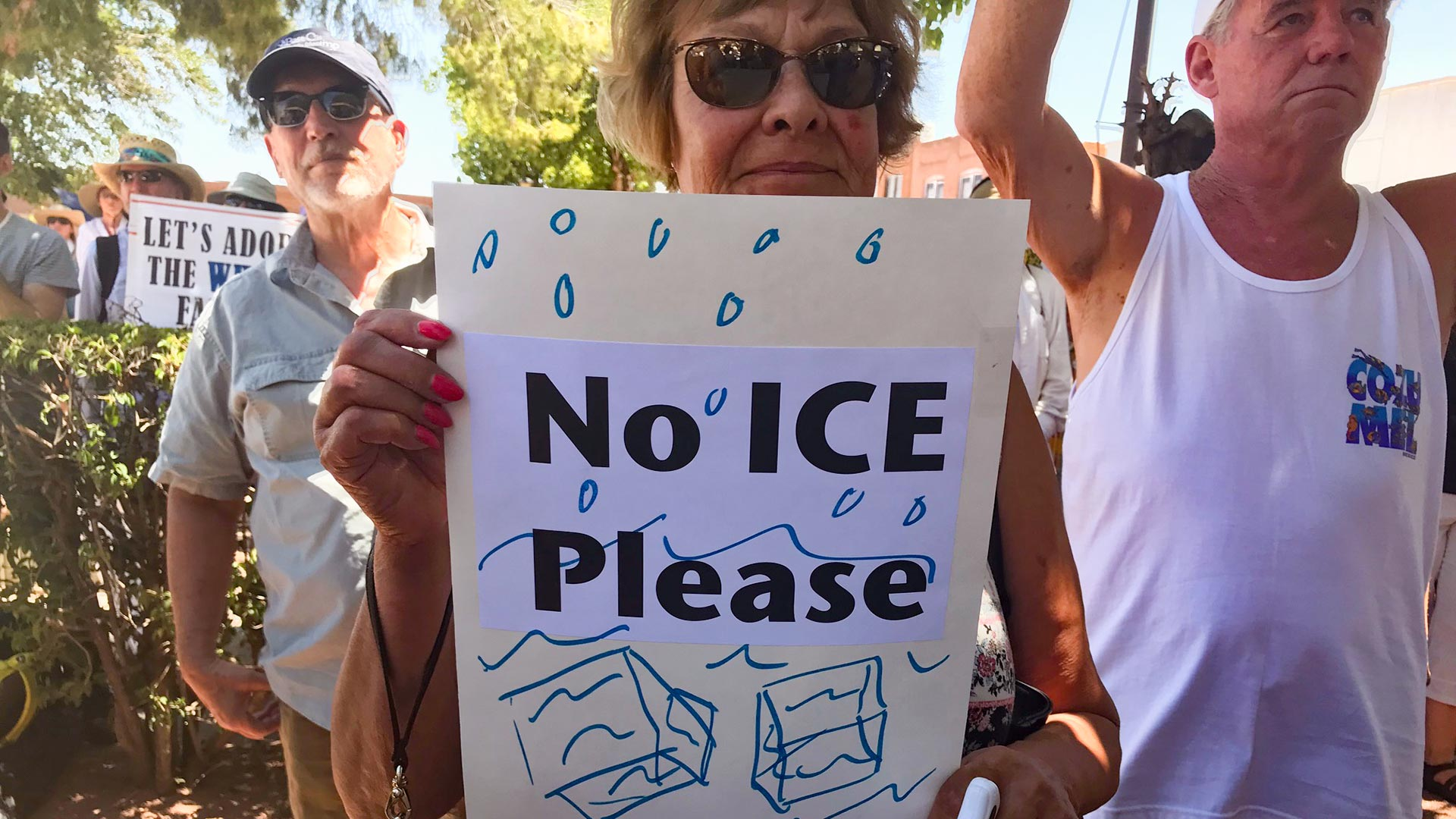 A protester holds a sign at a border demonstration in Nogales, Arizona. (June, 2018)