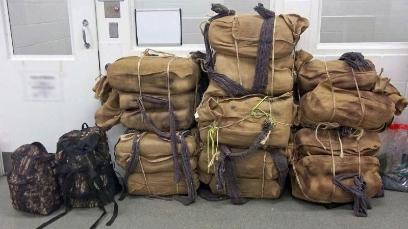 A policy change at the U.S. attorney's office in Arizona increases penalties on marijuana smugglers who cross the border on foot with backpacks, like these seized in 2017.