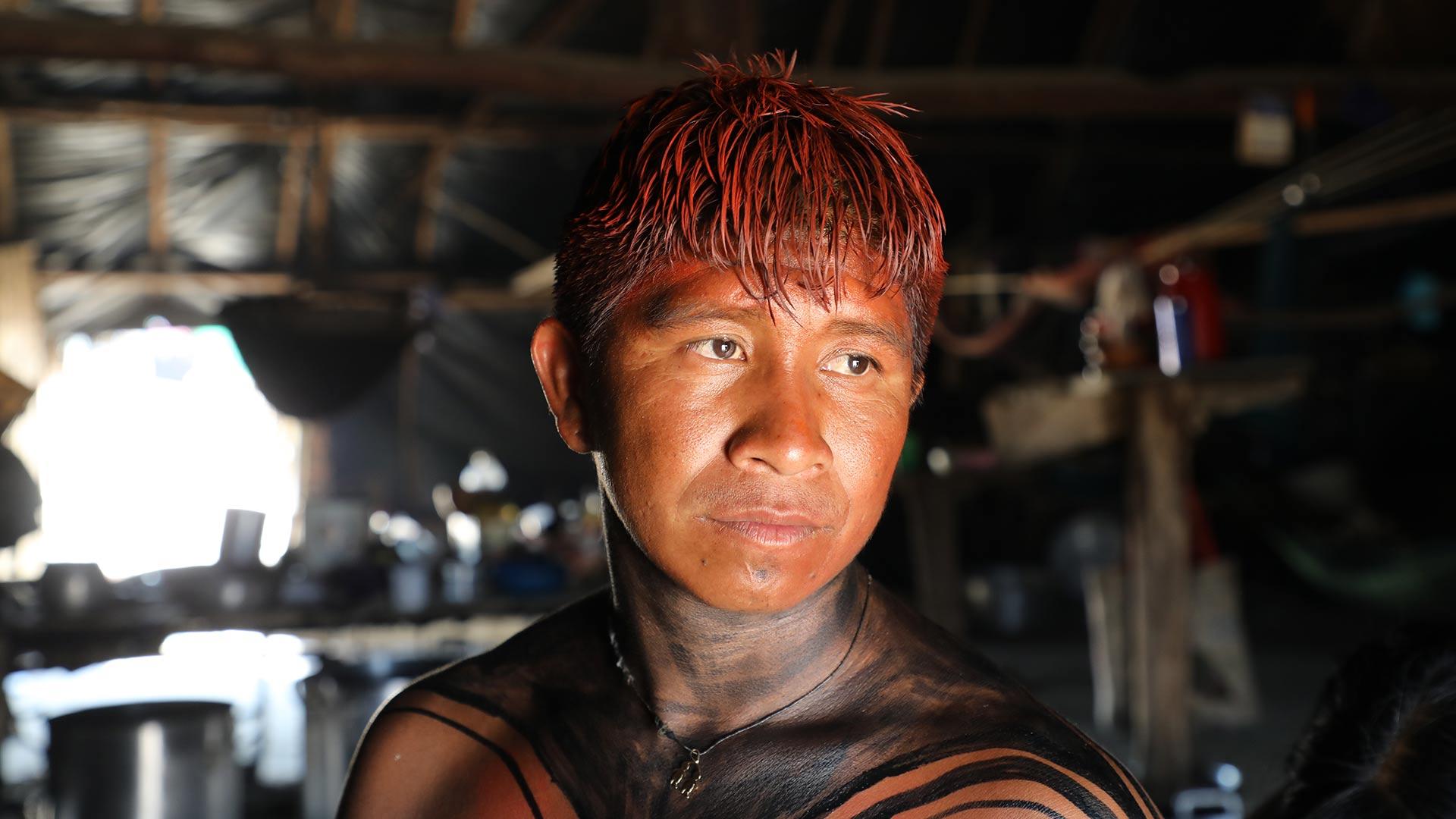 Kotoc in attire for feast in honor of the parrot spirit, Xingu, Brazil.