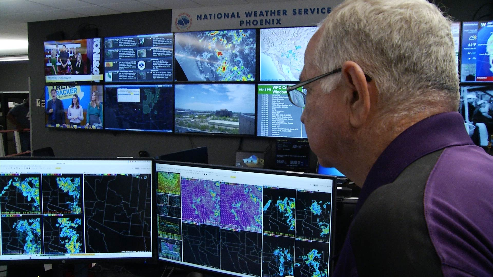 Meteorologist Ken Waters examines weather maps and radars at the National Weather Service's headquarters in Phoenix.
