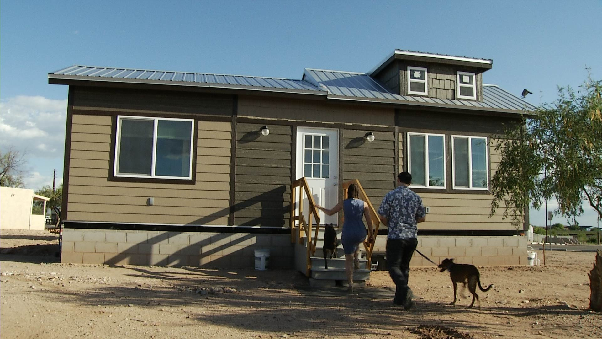 Sydney Scharer, a teacher in Vail, and Simon Stickworth walk into their tiny home they are renting as part of an initiative by the Vail School District to provide employees with affordable housing in the community.