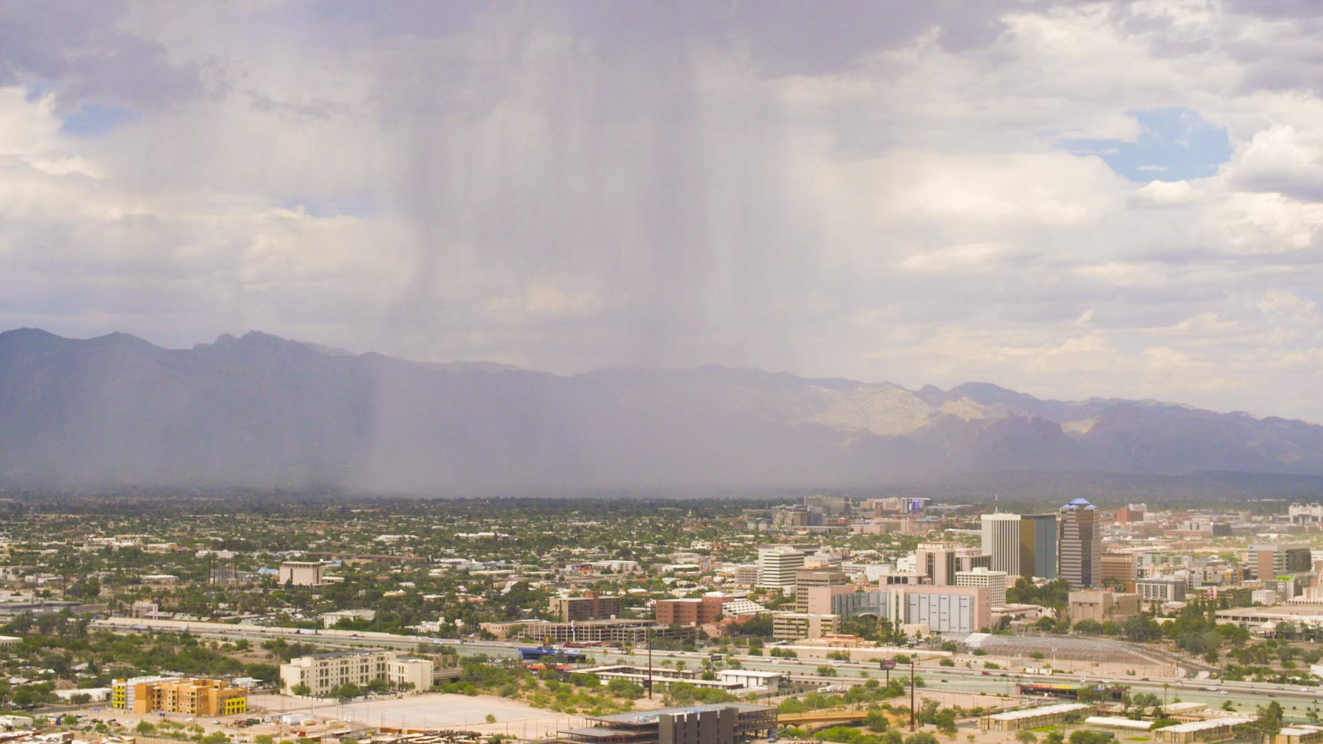 Rain and sunlight interact over Tucson, July 5, 2018.