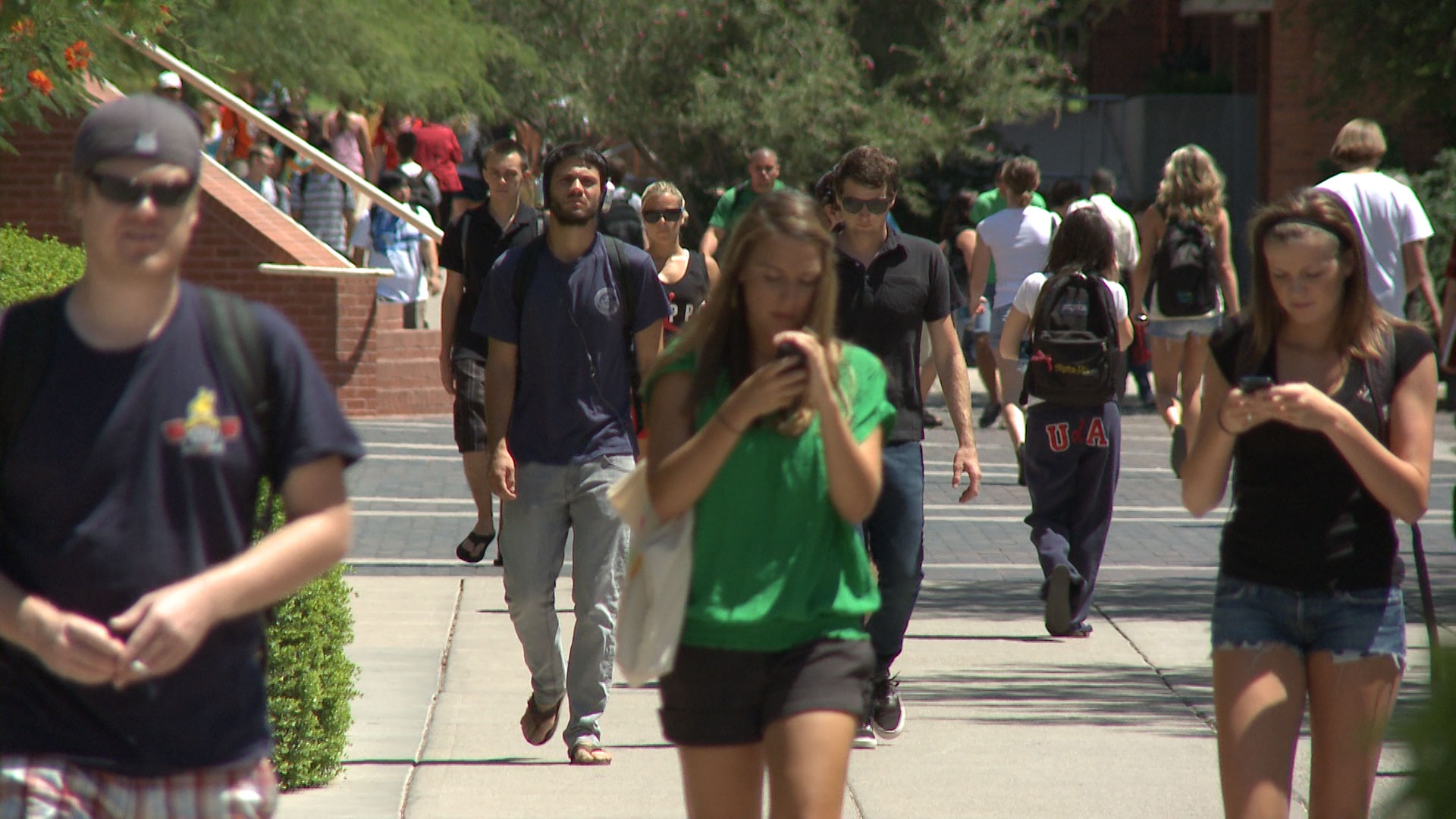 Students walk on campus at the University of Arizona.