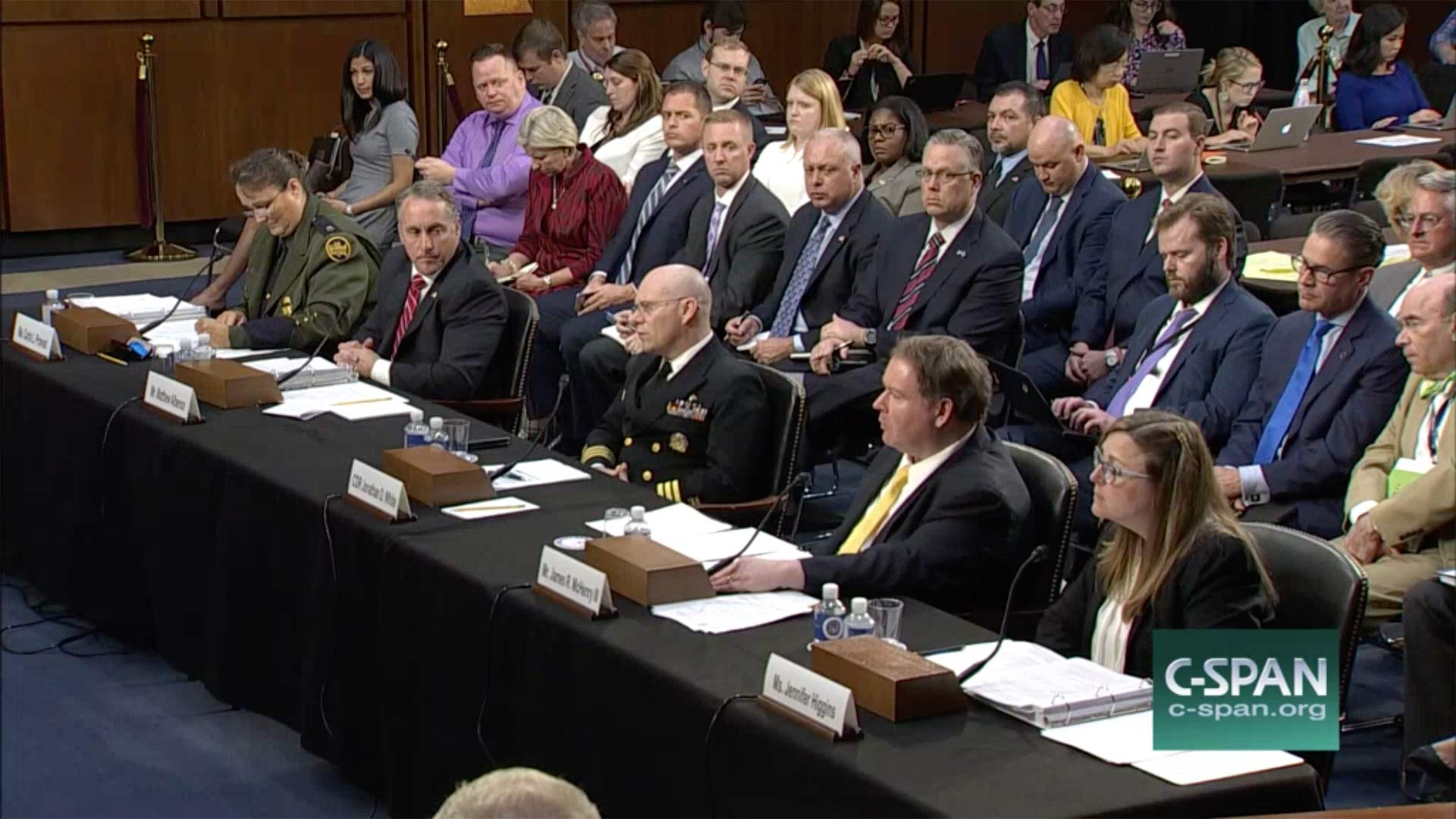 In this image from C-Span video, senior immigration officials sit before the Senate Judiciary Committee July 31, 2018, at a hearing about the separation of immigrant families.