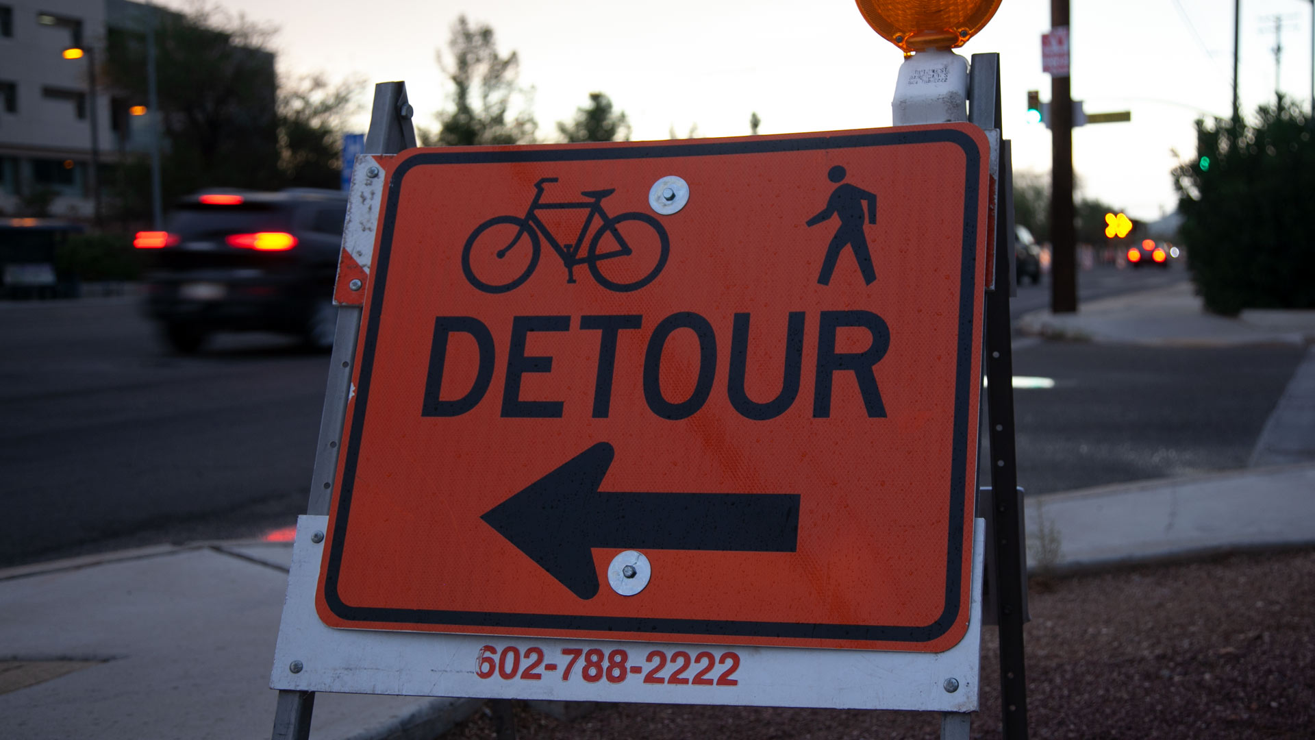 A sign indicates a detour for pedestrians and cyclists to bypass construction on Elm Street, near Campbell Avenue. From August, 2018.