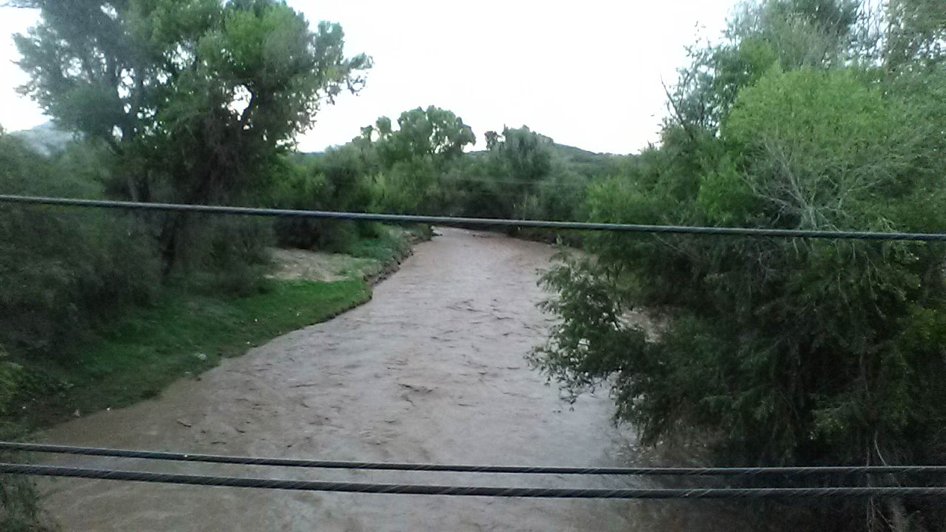 Nogales Wash in downtown Nogales, Arizona running bank to bank. (August 13, 2018)