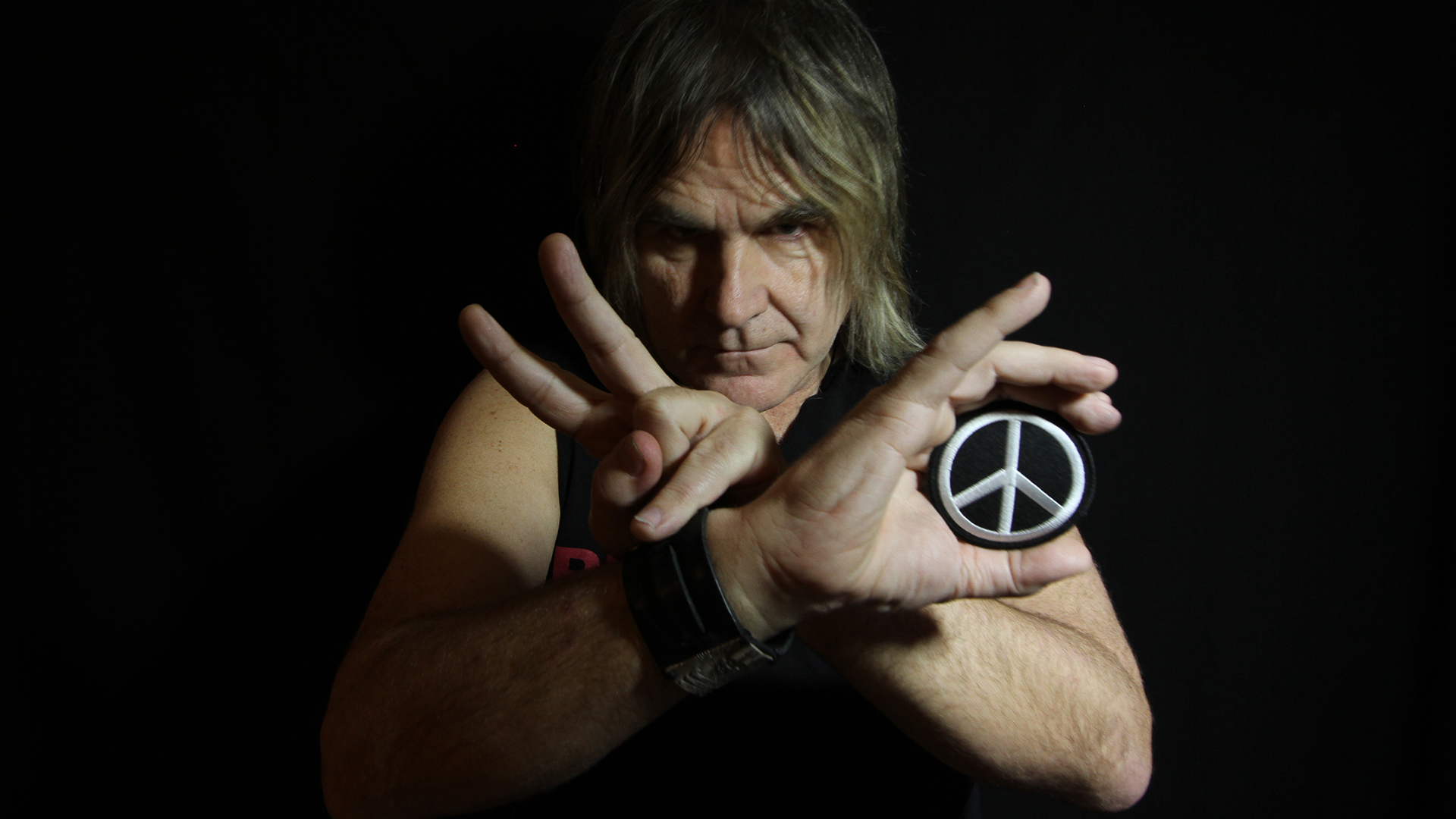 mike peters peace symbol hero