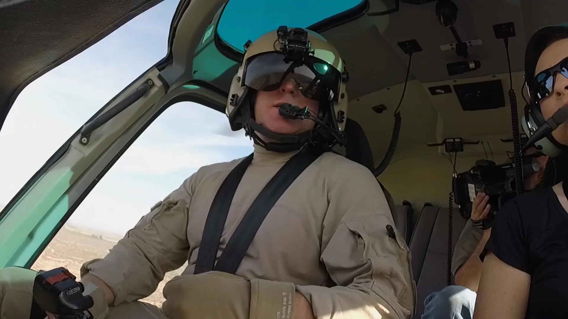 An air interdiction pilot in the cockpit of a helicopter belonging to U.S. Customs Air and Marine in Customs and Border Protection's Yuma Sector.