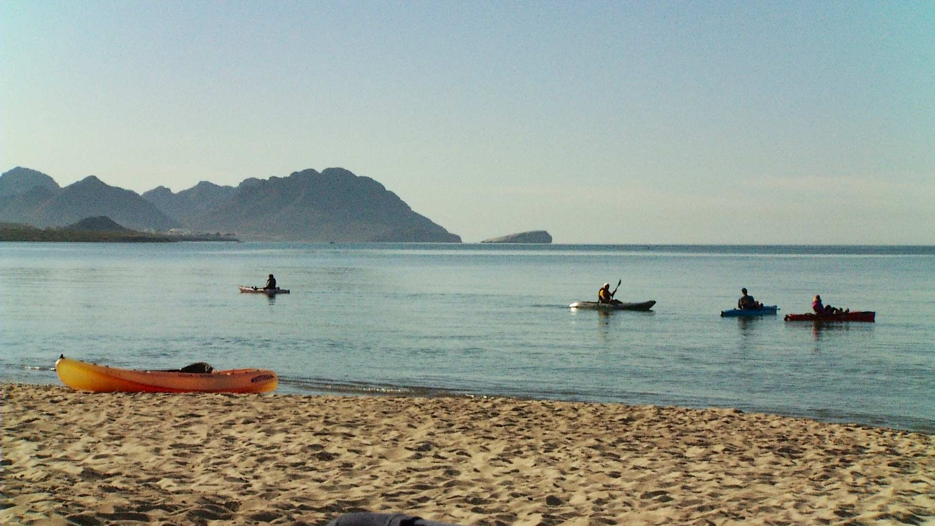 Kayakers at a beach in San Carlos.