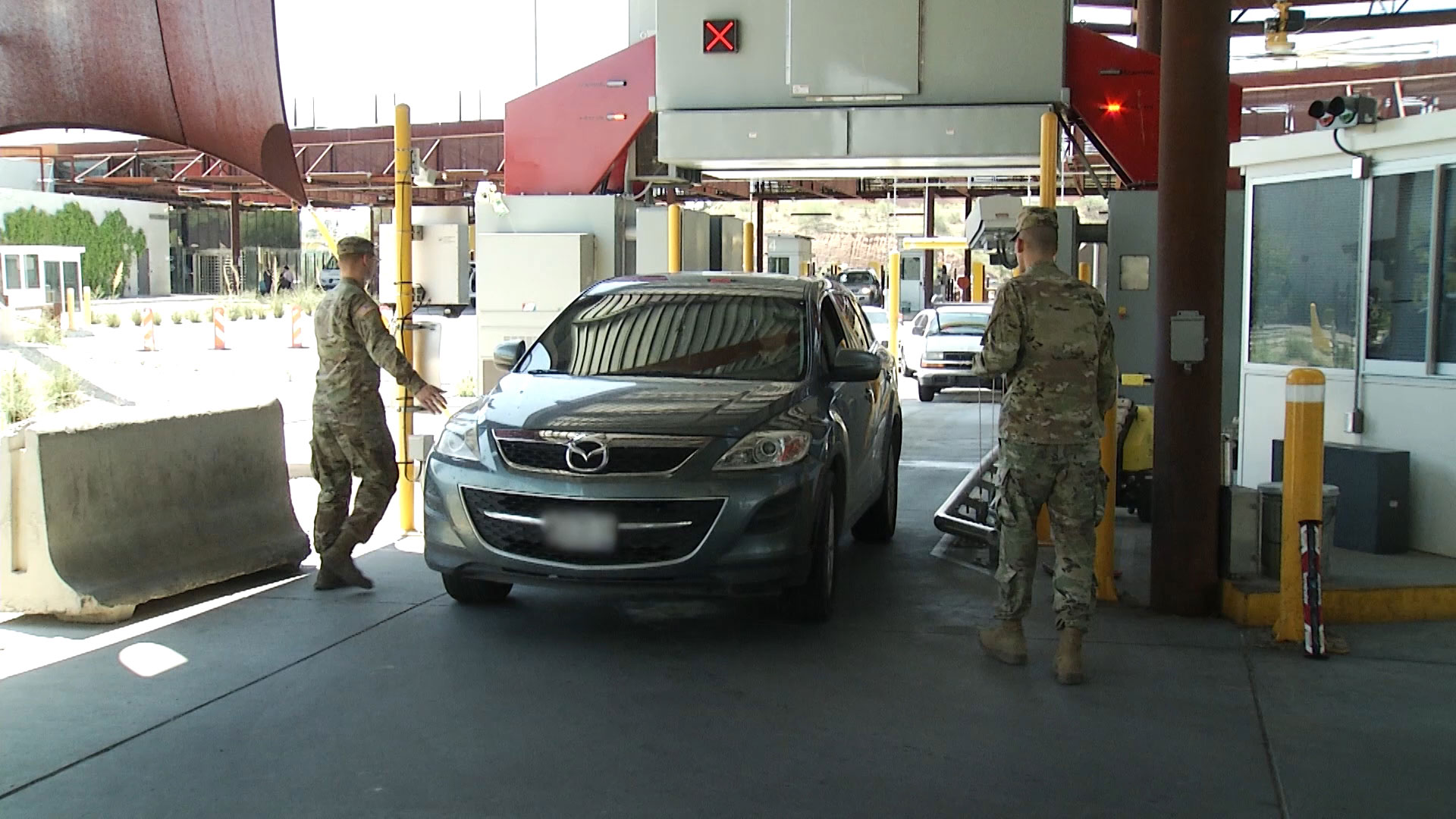 Members of the National Guard assist customs officers at the Mariposa Port of Entry in Nogales as part of their deployment to border states.