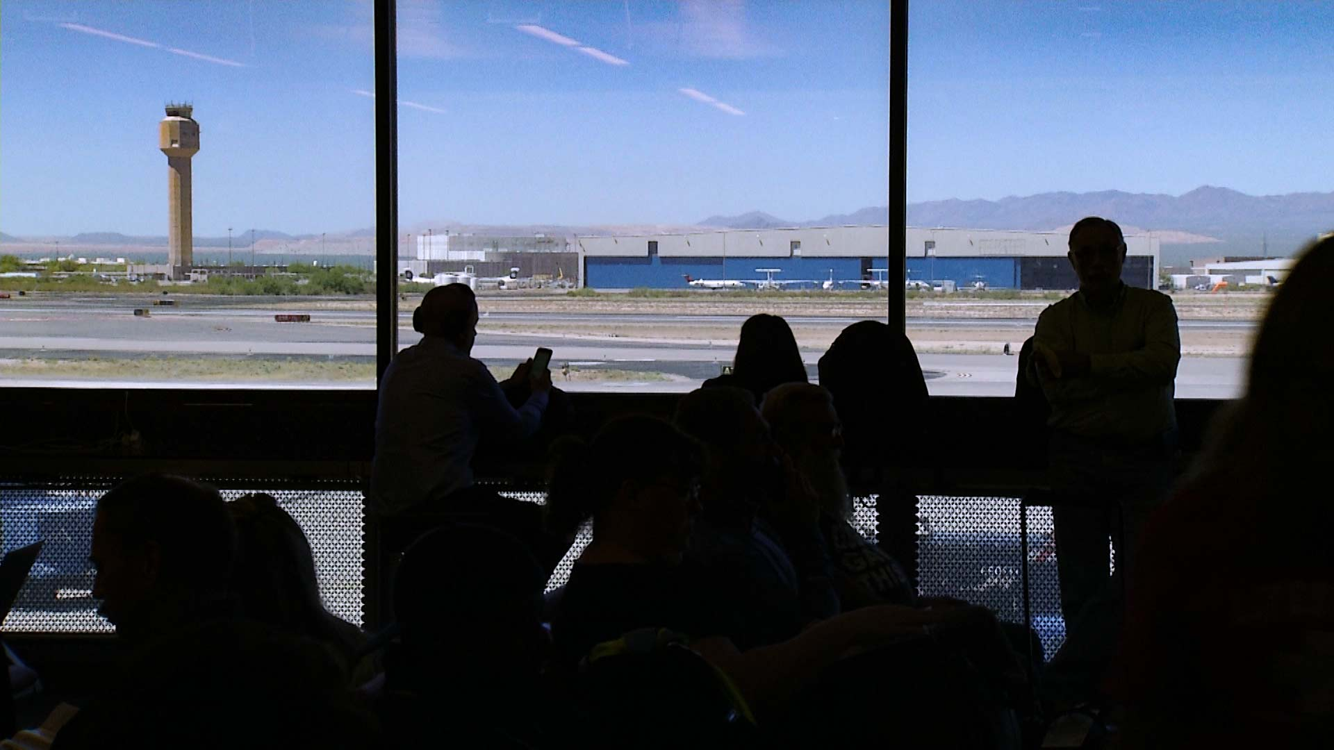 Looking out at the tower at the Tucson International Airport.