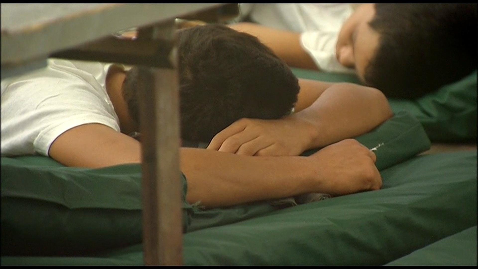 Immigrant children rest at a detention facility in Nogales, Arizona in 2014.