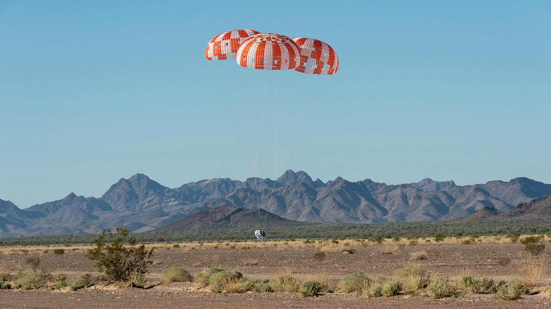 Touching down during a Sept. 12 parachute test for the Orion spacecraft at the Yuma Proving Grounds.