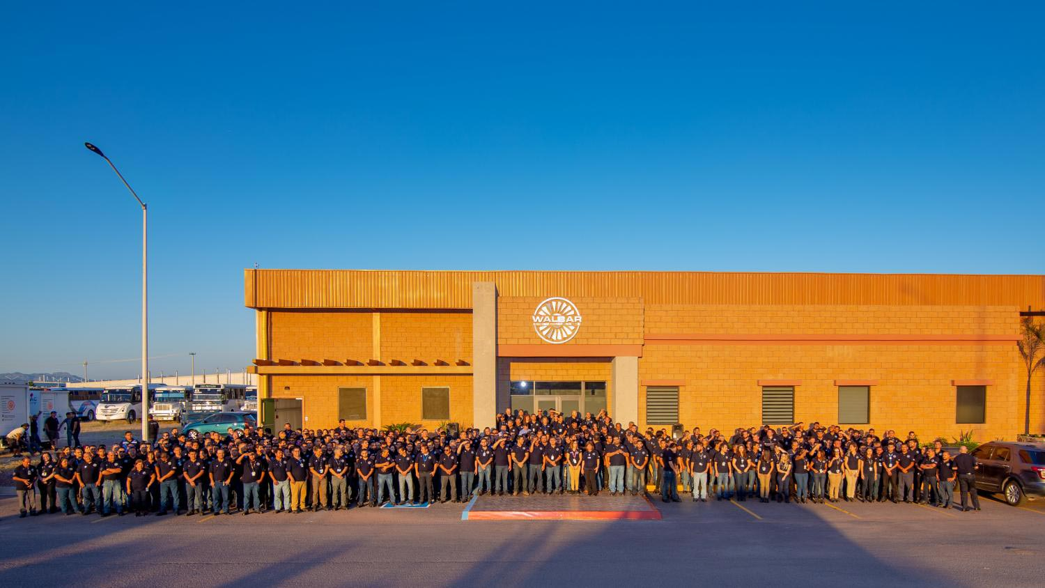 Walbar employees stand in front of the recently completed manufacturing facility in Guaymas, Sonora.