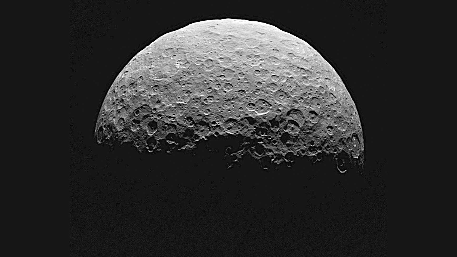 Scientists think material from ice volcanoes once flowed across some of Ceres' now-cratered surface. Image from NASA's Dawn spacecraft.
