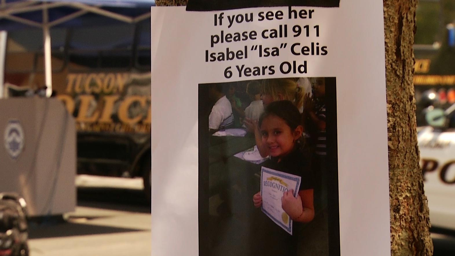 A poster for Isabel Celis, 6, posted on a tree shortly after her disappearance in 2012.