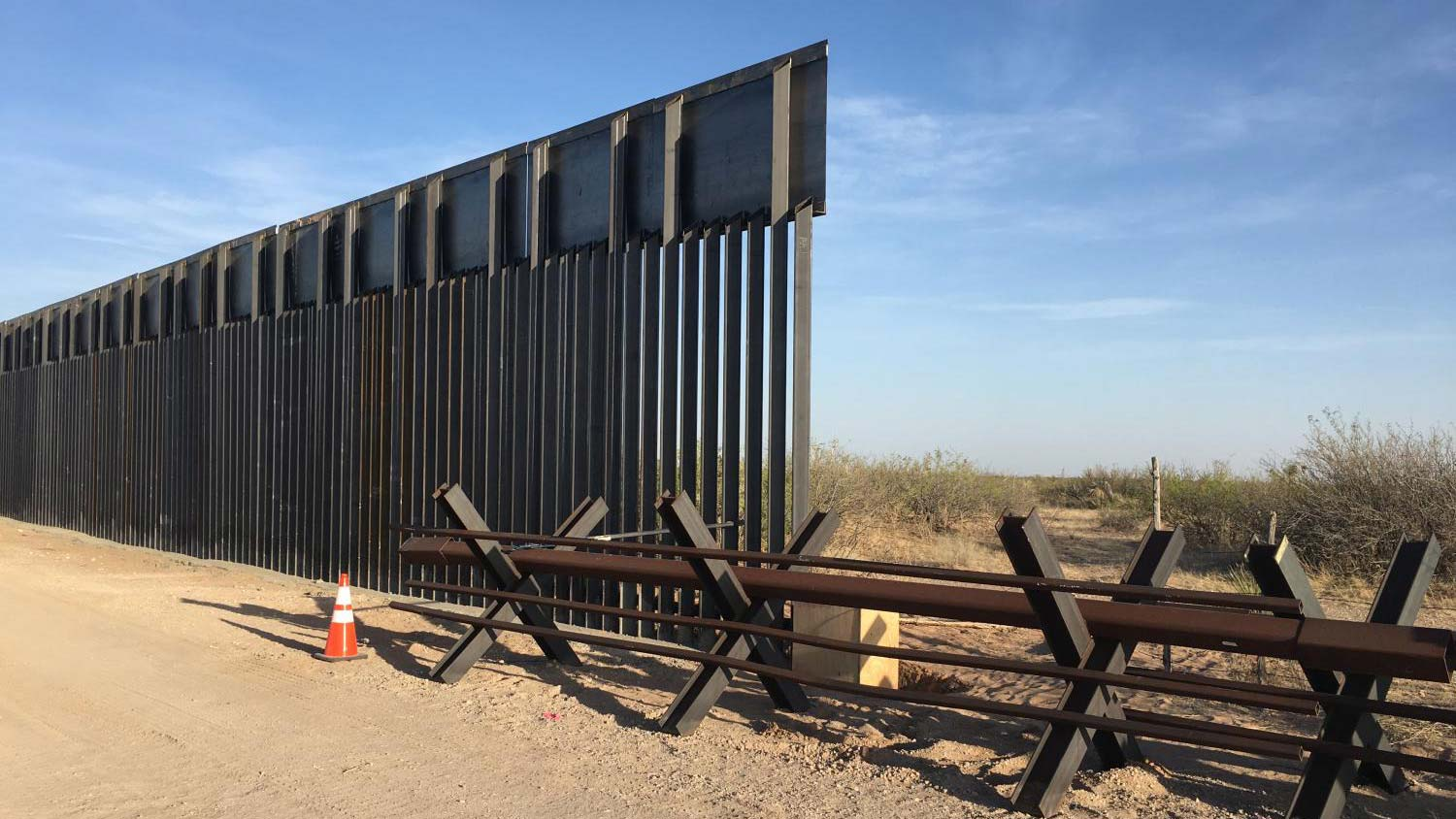 A bollard-style steel border wall, like this one in Sunland Park, New Mexico is being built west of El Paso's main border crossing.