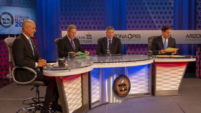 A scene from Monday night's debate among candidates for governor. From left, Democrat David Garcia, moderator Ted Simons, Green Party candidate Angel Torres and Republican Doug Ducey.