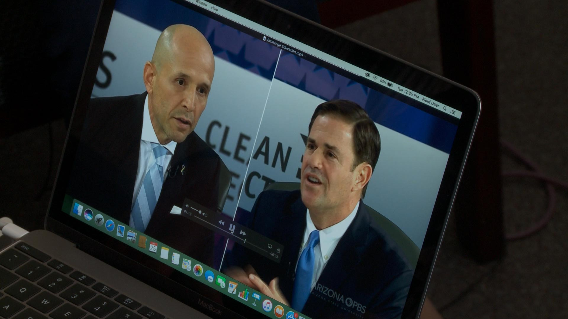 A laptop plays a clip showing Republican Gov. Doug Ducey and Democratic challenger David Garcia at their first debate hosted by Arizona PBS and the Citizens Clean Elections Commission in Phoenix. The first debate took place September 24, 2018.