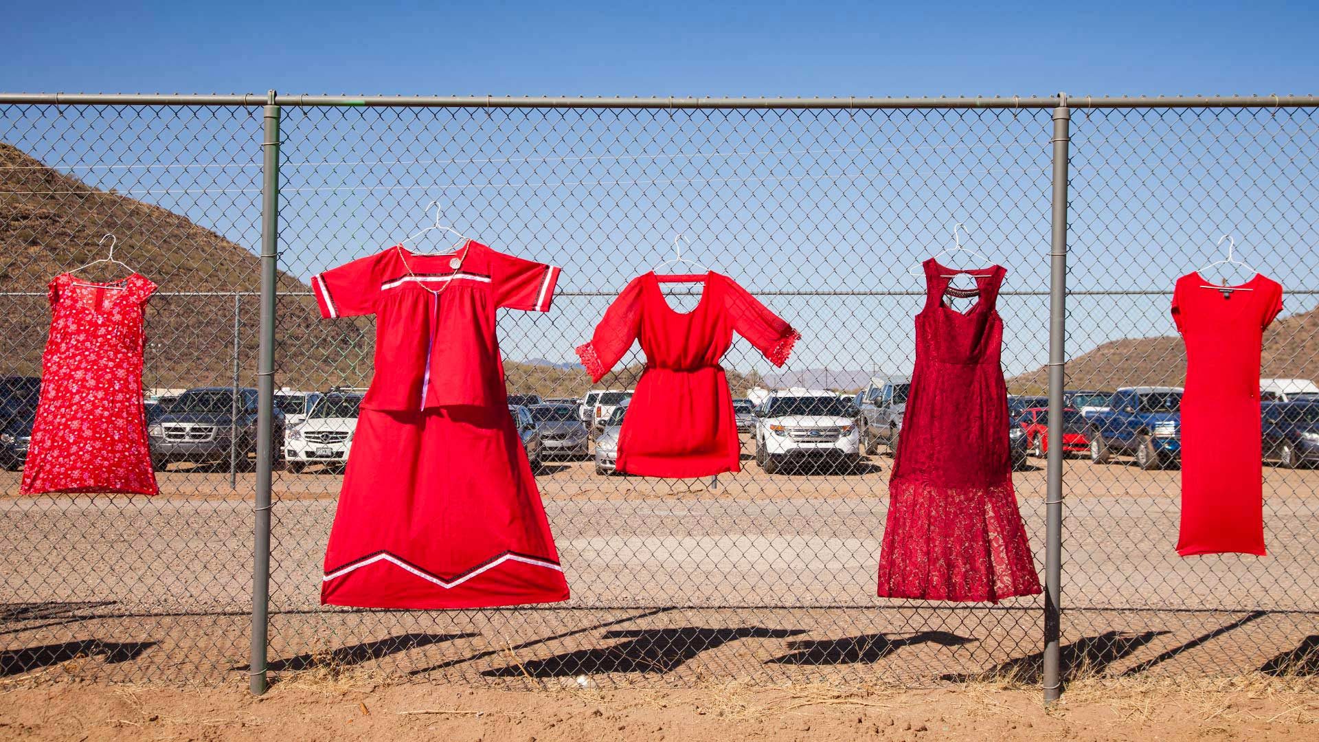 Red dresses representing missing and murdered indigenous women, displayed at the Verna N. Enos Toka Field on the Tohono O'odham Nation, 2018.