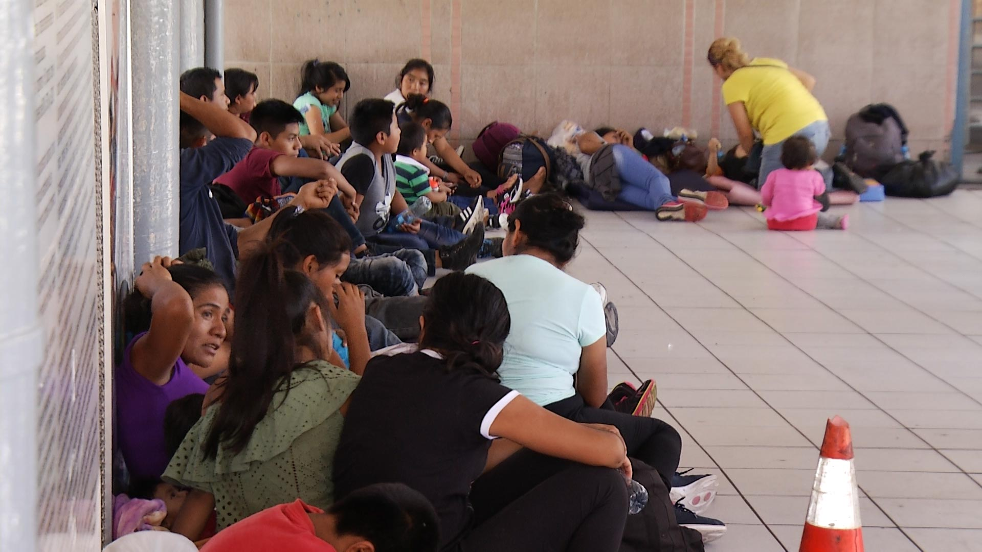 Families seeking asylum await processing outside the port of entry in Nogales, Sonora, on Sept. 4, 2018.