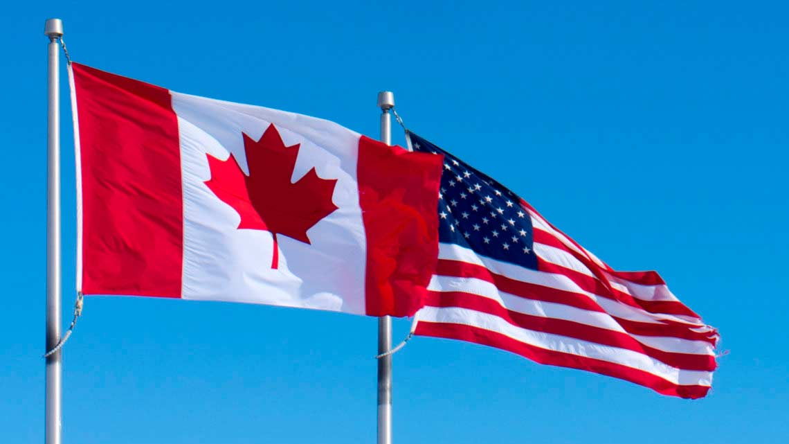 The flags of Canada and the U.S.