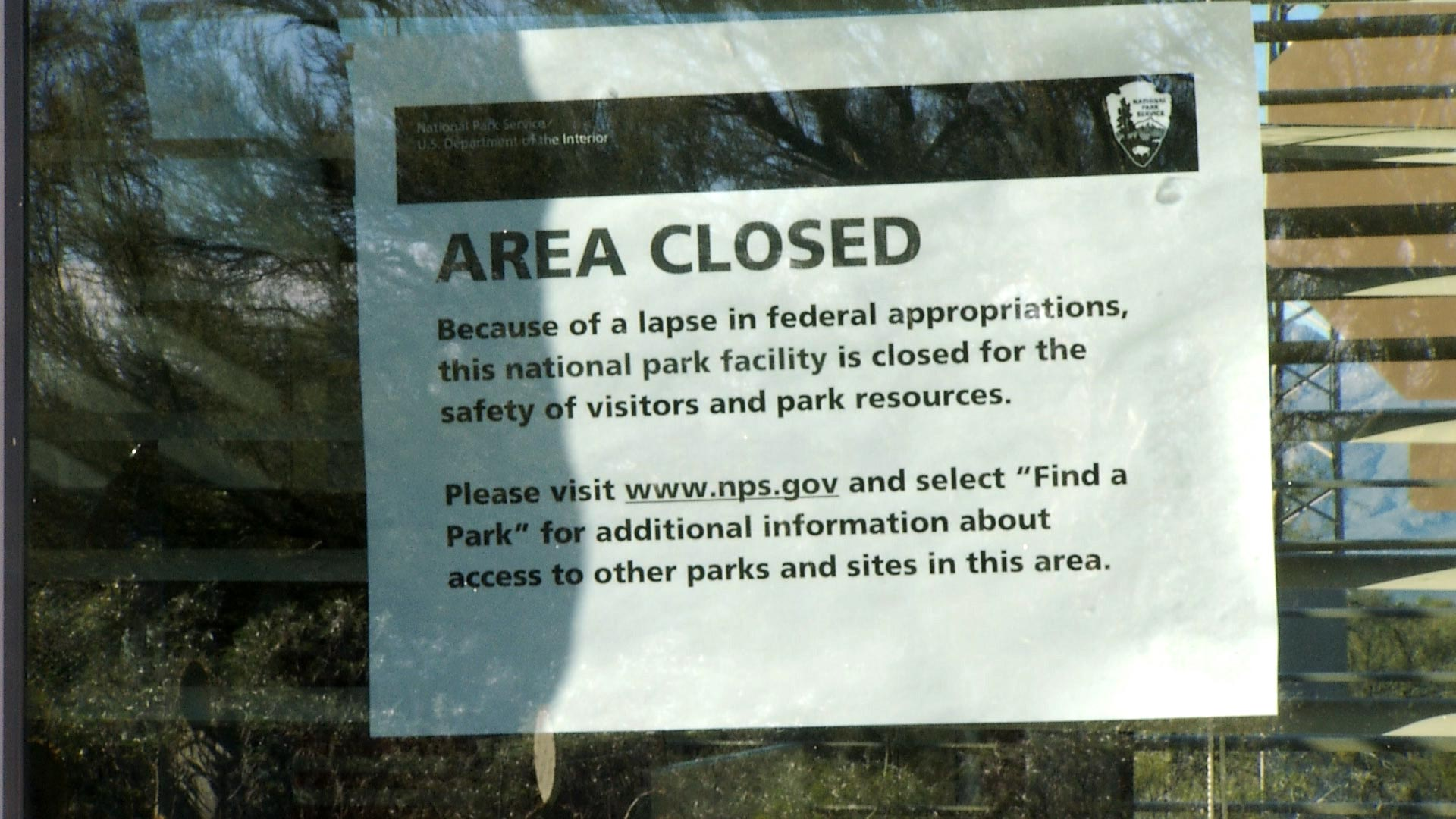 A temporary sign notifies visitors at Saguaro National Park East of closures associated with the partial government shutdown as it entered its third week on January 8, 2019.