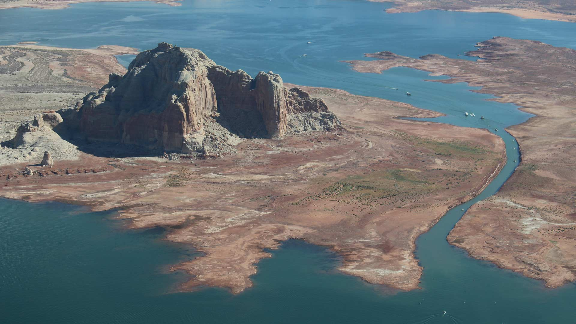Lake Powell on the Utah-Arizona border continues to drop as snowpack declines throughout the southwestern U.S. The narrow passageway shown here in September 2018 has been rendered unusable as water levels drop.