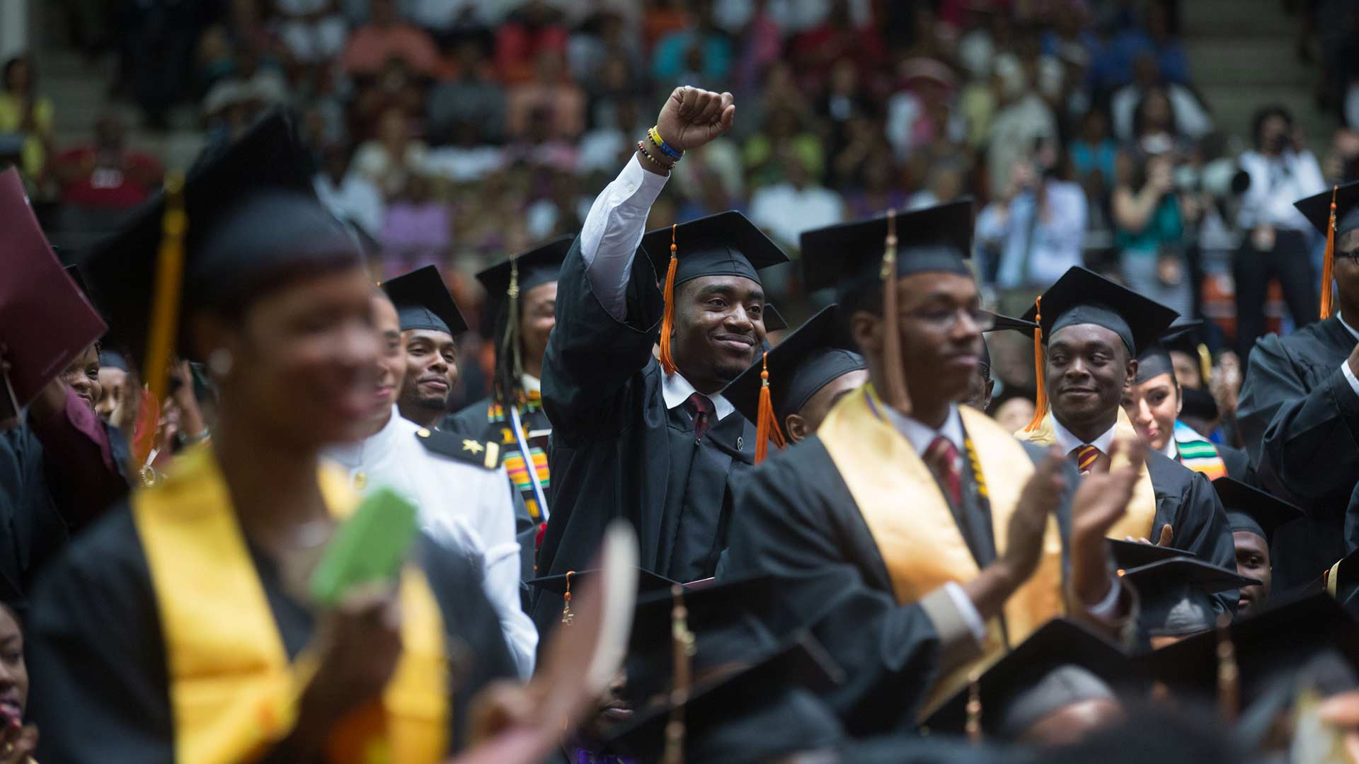 Students listen to then-First Lady Michelle Obama's remarks for the Tuskegee University commencement ceremony in Tuskegee, Alabama, May 9, 2015.