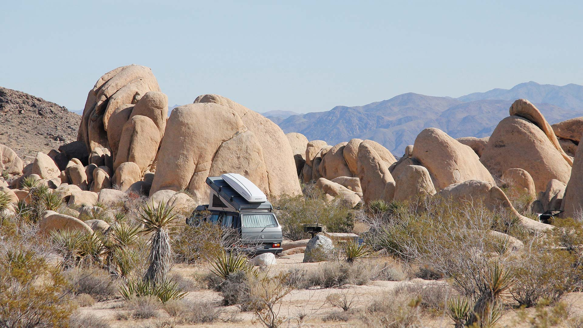A camper van at Joshua Tree's White Tank Campground.