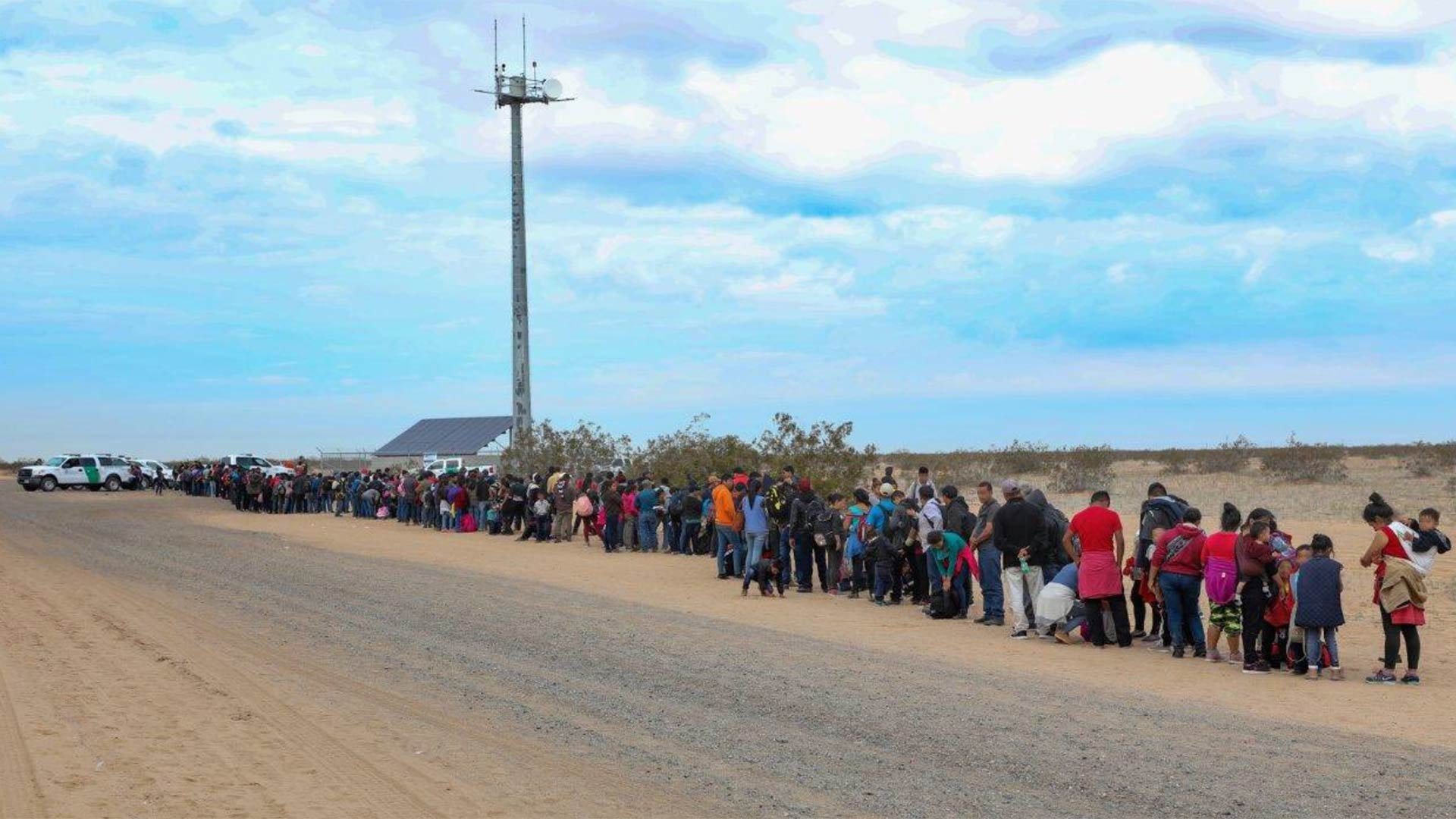 Migrants who crossed the border near Yuma in tunnels under the border fence stand in line waiting for Border Patrol agents to process them on Jan. 14, 2019.