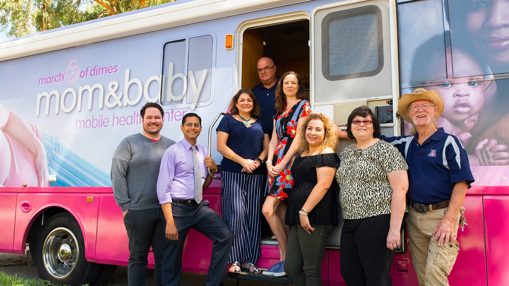 The Mobile Health clinic team (from left): Senior Program Coordinator Patrick Rivers, Medical Director Ravi Grivois-Shah, Community Health Educator Nury Stemple, driver Jesus Marquez, nurse practitioner Elizabeth Knight, medical assistant Edna Rodriguez, nurse practitioner Angela Brown and driver Greg Loring.