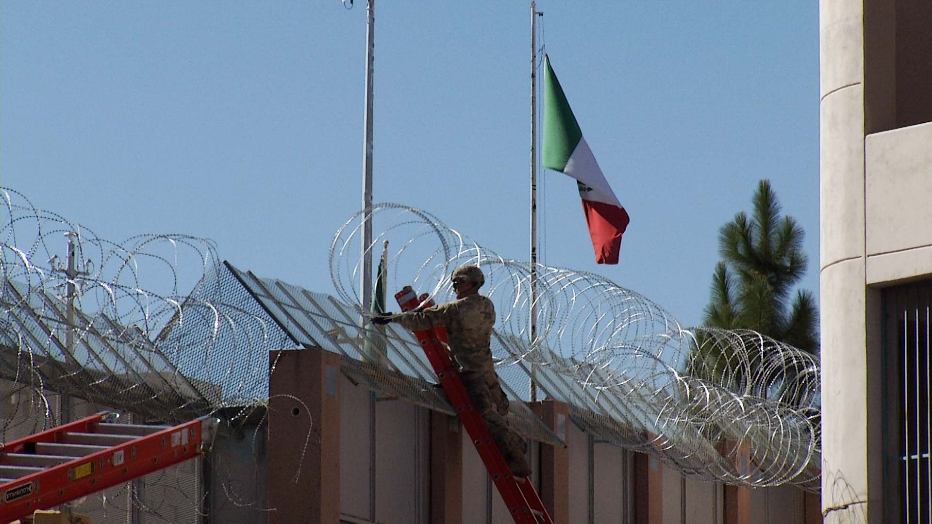 A soldier installs concertina wire along the border wall near the Dennis DeConcini Port of Entry in Nogales on Thursday, Nov. 15, 2018. A new deployment is expected to stretch an additional 150 miles of razor wire along the border.