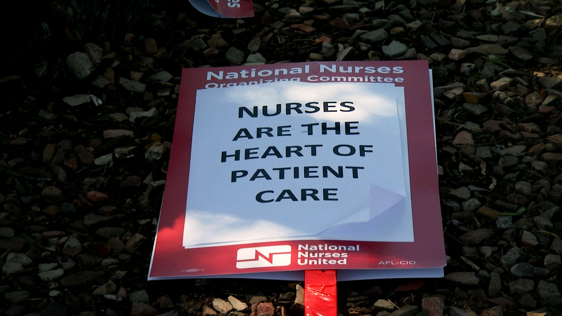 A sign used by nurses participating in a one-day strike outside St. Mary's Hospital on September 20, 2019.