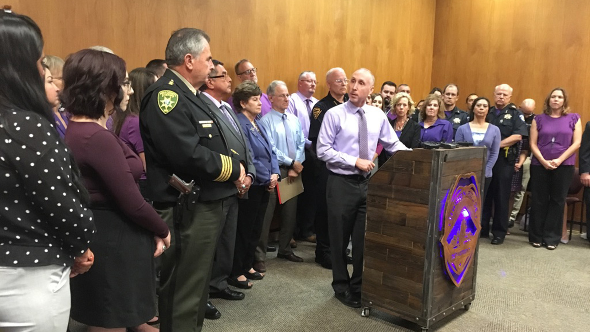 Ed Mercurio-Sakwa, the CEO of Emerge! Center Against Domestic Abuse, speaks to a group of city and county officials and staffers at a press conference for Domestic Violence Awareness Month October 1, 2019.