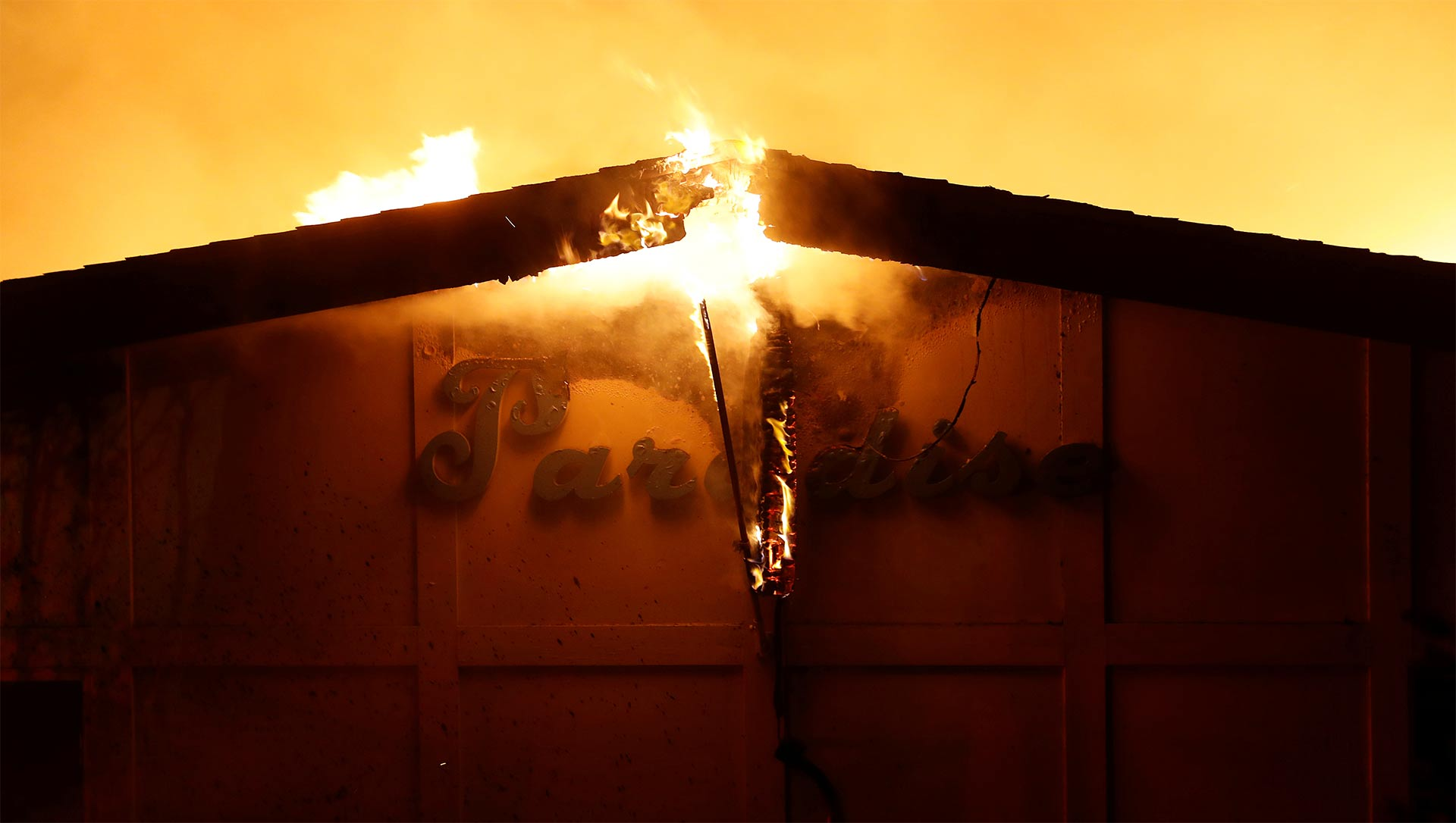 A burning sign is seen outside Paradise Skilled Nursing home during the Camp Fire in Paradise, California, U.S. November 8, 2018.