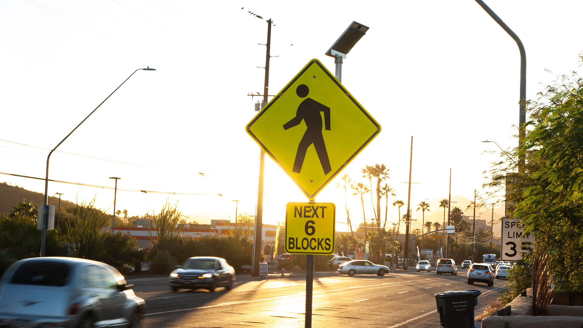 A sign warning drivers of high pedestrian traffic on West St. Mary's Road in Tucson on a late October afternoon.
