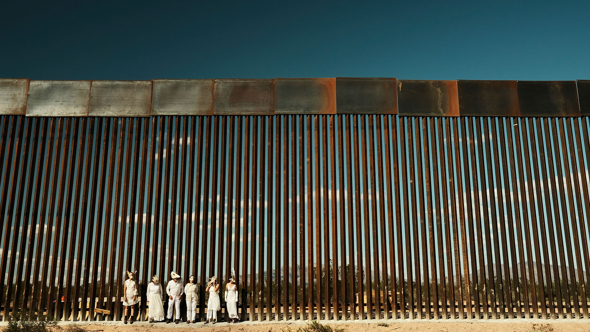 Artists at border wall