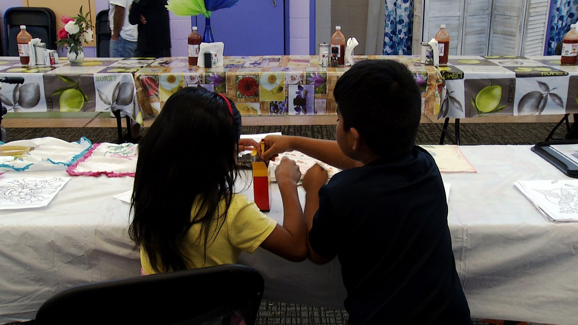 Two children color at Casa Alitas' shelter for migrants and asylum-seeking families on Sept. 30, 2019.