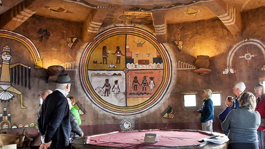 Visitors observe murals inside of the Desert View Watchtower at the Grand Canyon, in this National Parks Service media release photo.