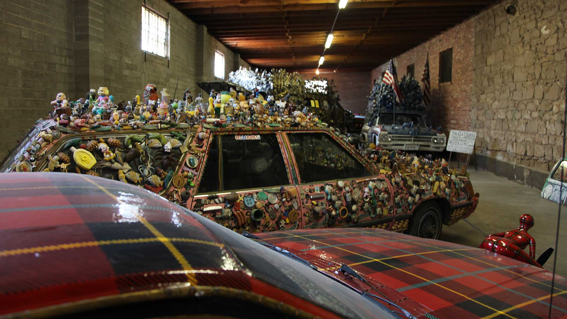 Art Car World is a museum that exhibits decorated vehicles from different places and artists.