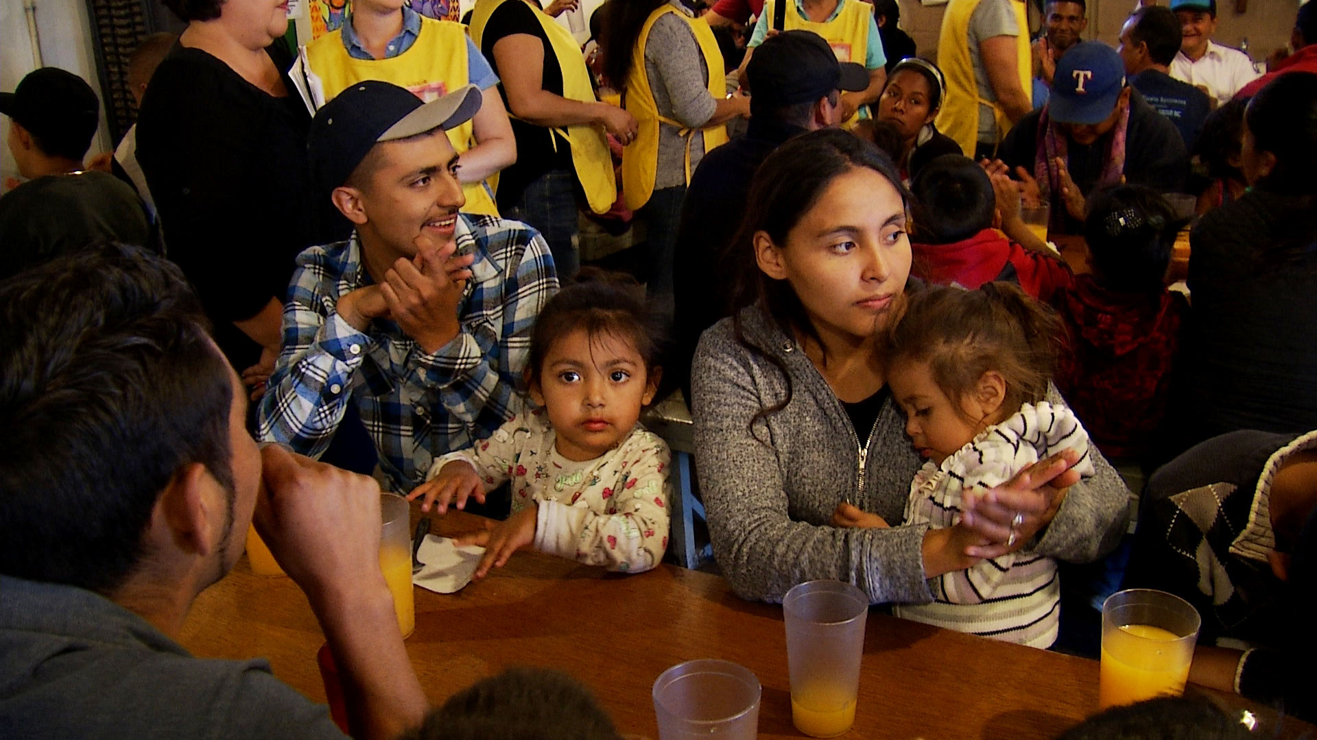 A family awaits meal service at Kino Border Initiative's aid center in Nogales, Sonora on October 29, 2019. The nonprofit assists migrants and deportees in the city.